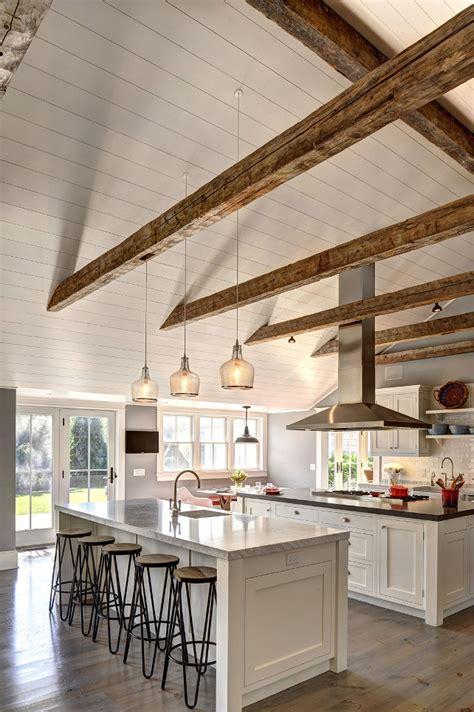 two island kitchens belki stropowe na pierwszym planie mieszkaniowe inspiracje