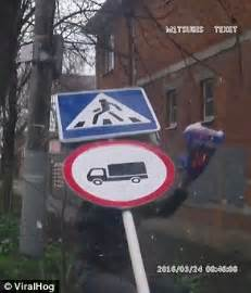dashcam video shows a man flattened by a road sign after a