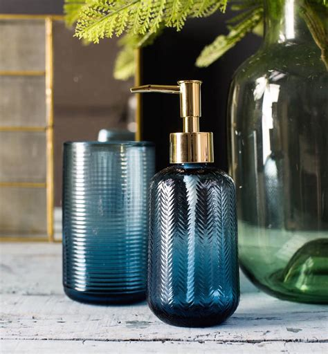 blue green glass drop dispensing etched blue glass soap dispenser by the forest co