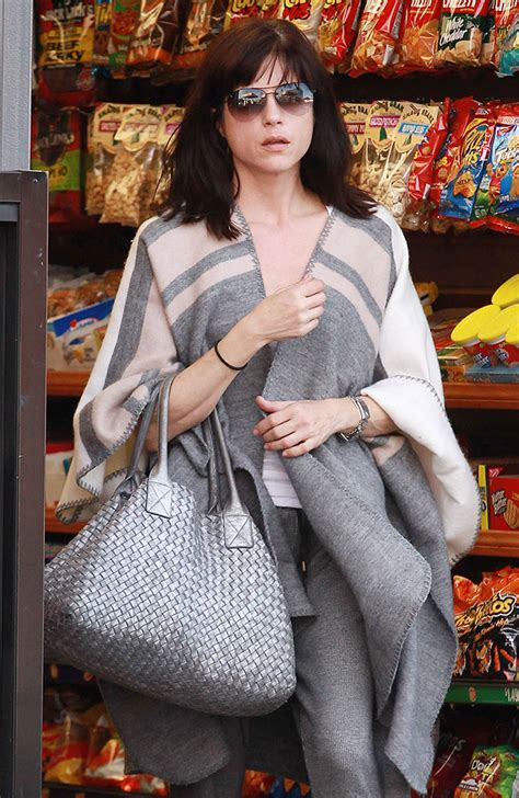 Pam Andersons Bottega Veneta Cabat Handbag by Look Uncertain About Their Fashion And Choices