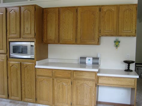 can you stain kitchen cabinets can you stain your kitchen cabinets without sanding them