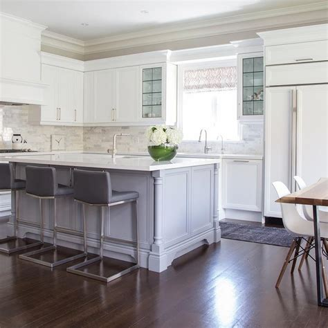 white kitchen island with stools island with gray leather counter stools with nailhead trim