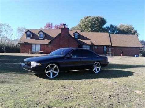 "sell used black 1996 chevy impala ss with 24"" ""iroc"" rims"