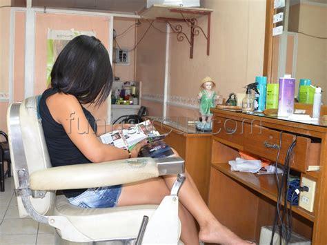 female in barber chair getting buzzcut fun hair cut more