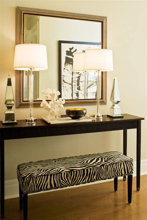 console table with bench underneath zebra ottoman transitional entrance foyer elle decor