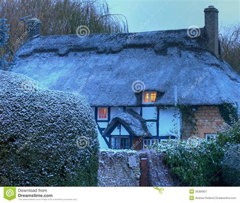 Interior Design Home Based Business thatched cottage with snow royalty free stock photography