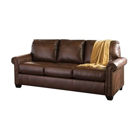 leather sleeper sofas queen ashley lottie leather queen sleeper sofa in chocolate
