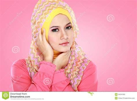 muslim pink portrait of beautiful wearing stock photo