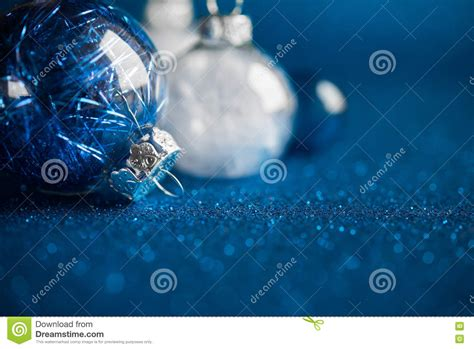 white blue ornaments white and blue ornaments on blue glitter