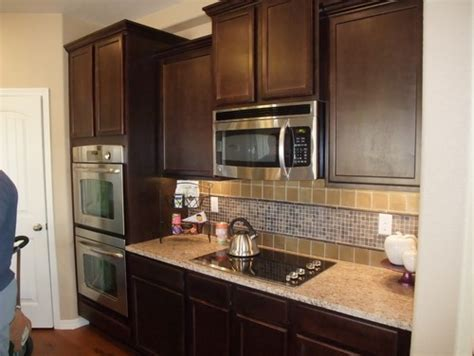 can i paint my kitchen cabinets should i paint my dark kitchen cabinets