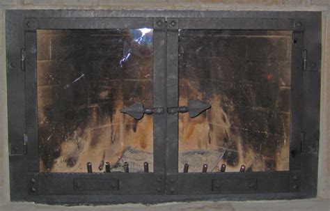 Adjustable Fireplace Doors by Wood Iron Works Custom Blacksmithing And Metal