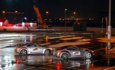 nissan 370z drift video nissan 370zs set world record for longest twin
