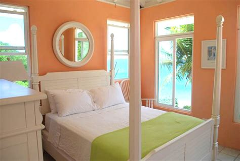 peach bedroom walls stay warm this winter in a tropical bedroom