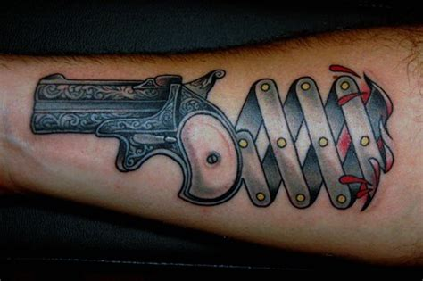 gun tattoo designs and the meaning