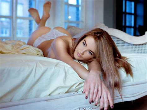 health benefits of sleeping without a pillow woman sleeping without pillow stretching in bed wearing underwear at night is good or bad for health