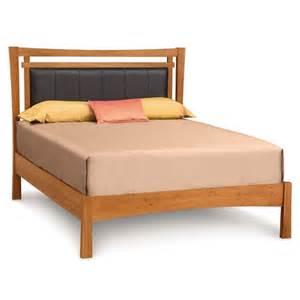 copeland monterey wood platform bed with upholstered headboard