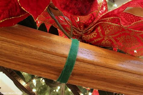 Garland Hangers For Banister by How To Hang Garland On Staircase Banisters Oh Creative