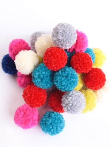 learn how to make pom poms and craft decorative items from them easy diy mini yarn pom poms using a fork