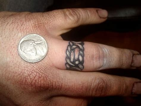 rose ring tattoo on finger images