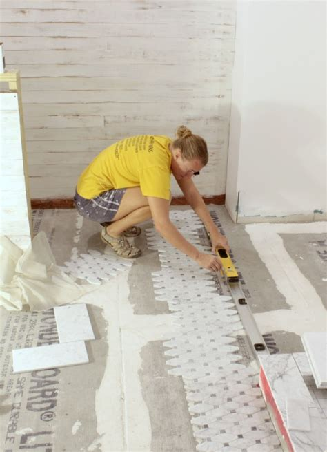 tiling a floor where to start cutting grouting and sealing marble tile tips