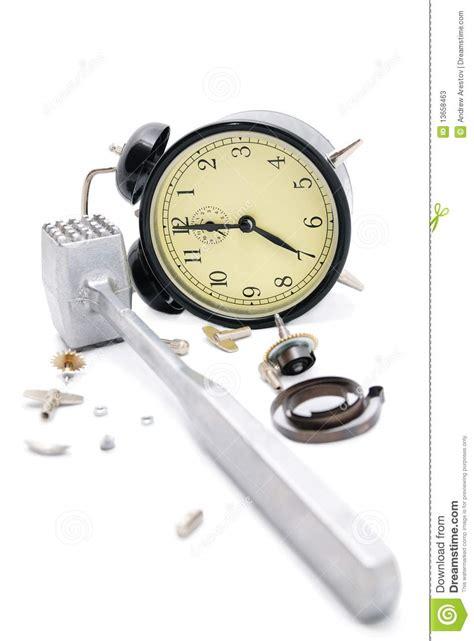 alarm clock broken   hammer isolate  white stock