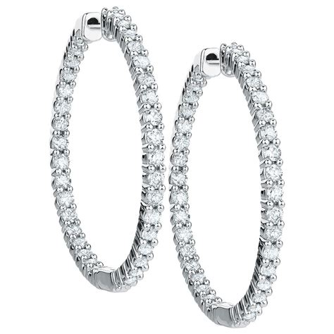 Hoop Earrings With hoop earrings with 1 carat tw of diamonds in 18kt white gold
