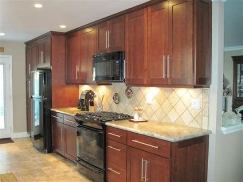 black kitchen appliances cherry cabinets with black appliances tile patterns