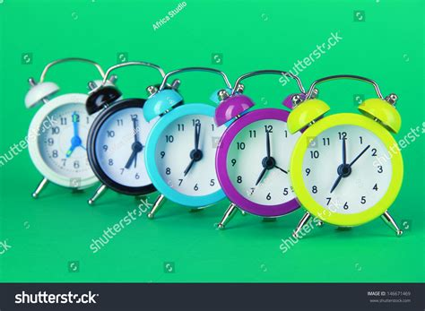 Colorful Clock Green colorful alarm clock on green background stock photo