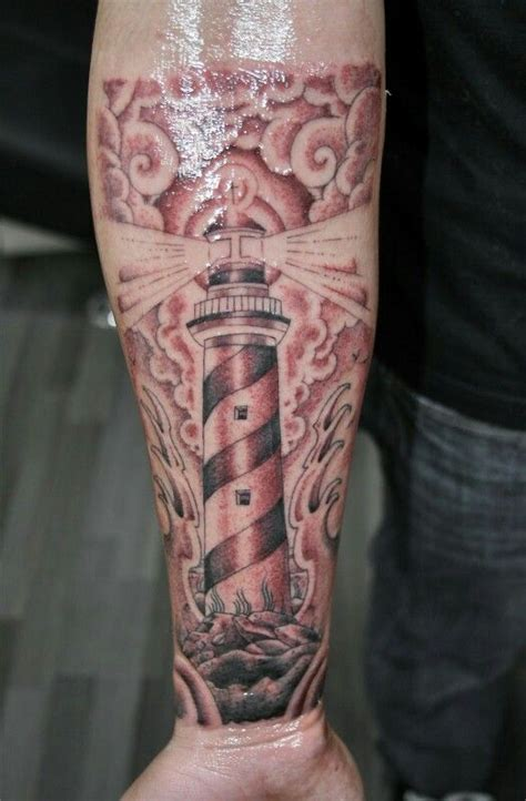 lighthouse tattoo in traditional american style forearm
