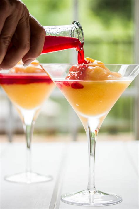 peach bellini cocktail with red wine homemade raspberry liqueur