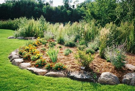 boulder and shrub berm landscaping berms for flood prevention pinterest shrubs