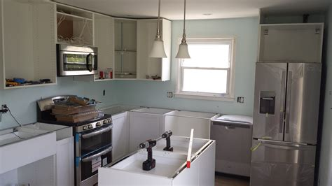 installing cabinets in kitchen installing ikea kitchen cabinets the diy way offbeat