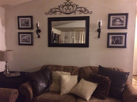 mirror in living room behind couch wall in living room mirror frame sconces