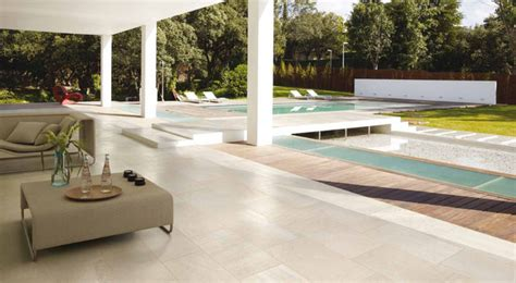 modern indoor outdoor patio pool area with porcelain