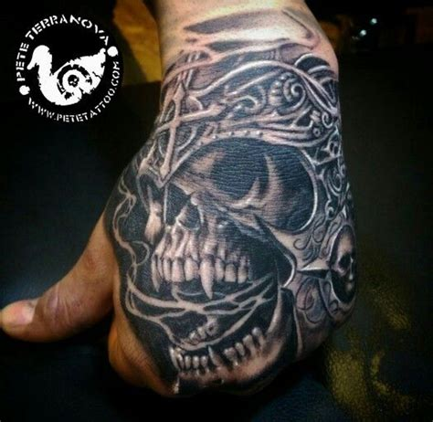 armored skull hand tattoo black and gray realism custom