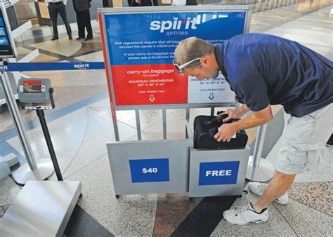 carry on fee spirit airlines begins denver service as customers grouse