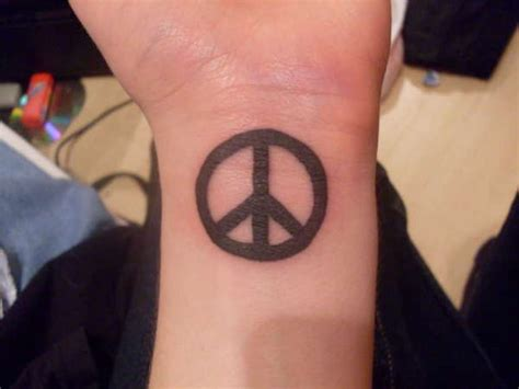 peaceful tattoos 36 classic peace symbol wrist tattoos design