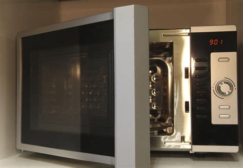 is it safe to put a microwave in a cabinet is it safe to put glass in the microwave leaftv