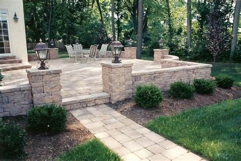 Raised Patio Designs The Patio Design Included A Raised Patio With A Custom Walkway Sitting Walls And Pillars With