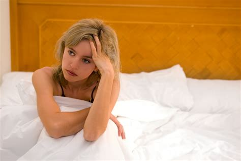 woman in bed 6 signs he s doing a slow disappearing act