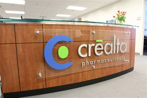 custom office desk signs crealta pharmaceutical office reception sign impact signs