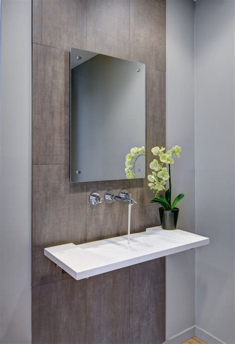 Mirrors For Powder Rooms - glamorous frameless mirrors in powder room contemporary with floating sink next to frameless