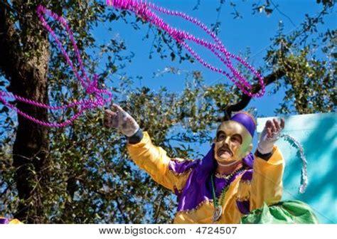 throwing at mardi gras mardi gras rider throwing image photo bigstock