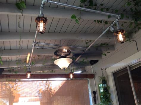 Patio fan and lights with galvanized pipe   I made this
