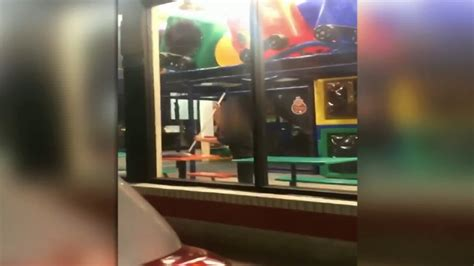 video burger king employee mops table  childrens play area