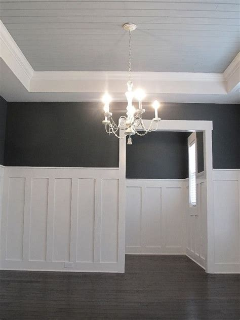 coffered walls high wainescotting white chandelier coffered ceilings