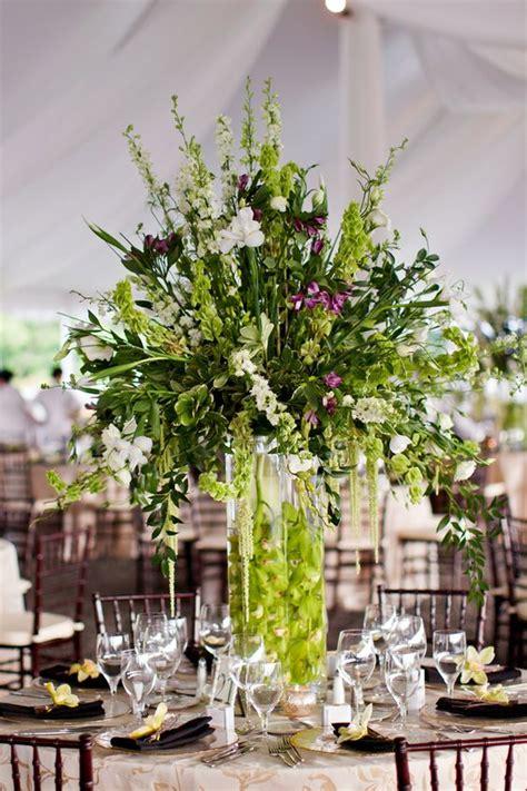 large reception arrangement green purple orchid