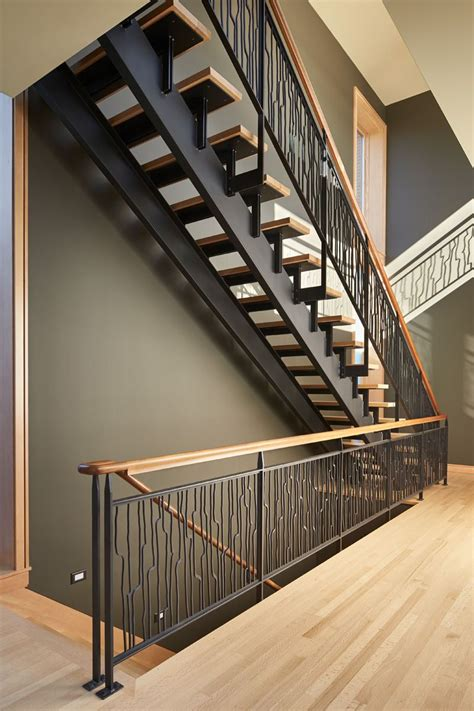 wood stair design these striking steel and wood stairs have water jet cut