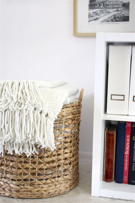 large basket for storing throw pillows gallery wall behind tv in living room house mix