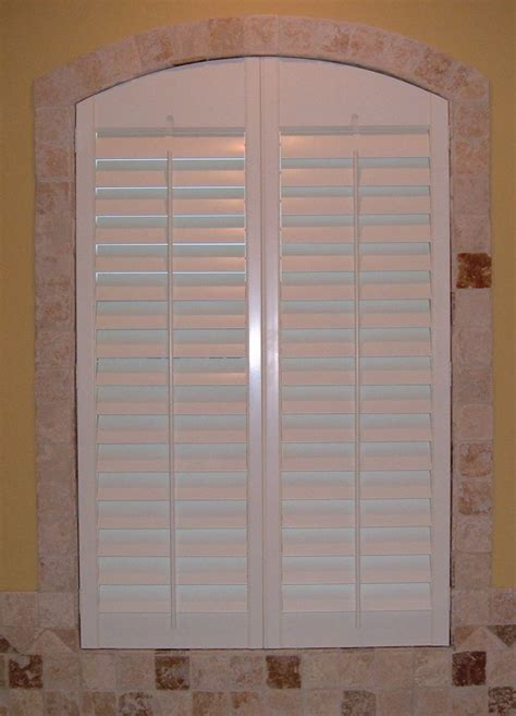 Bathroom Window Louvers Arched Bathroom Shutter Closed Shutters By The Louver